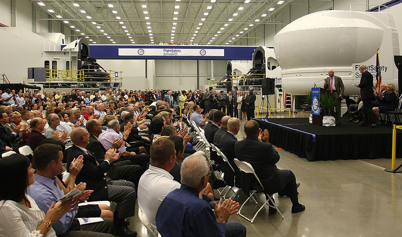 Employees and dignitaries attend the Grand Opening of the new Flight Safety facility in Broken Arrow Tuesday.