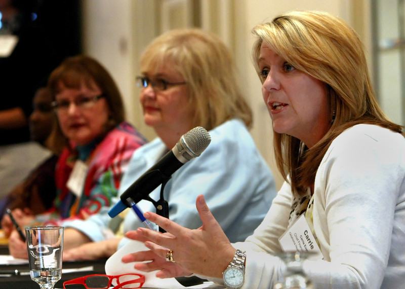 Carrie Evans (Right) answers questions from the audience at the Oklahoma Health Care Authority Board Retreat in Tulsa.