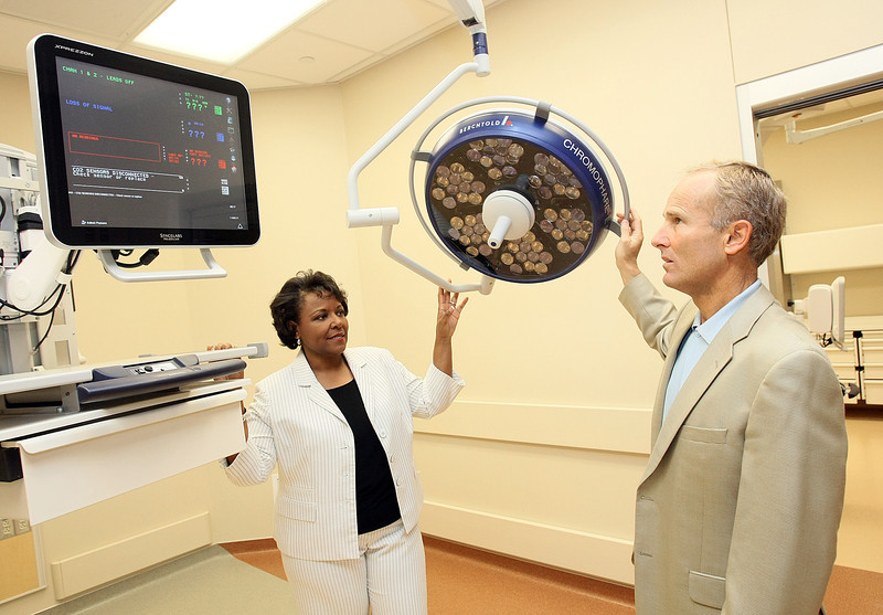 Avilla Williams, president of Integris Health Edmond, and Dr. William Smith check oout an emergency trauma room at the new facility on I-35 Monday.  PHOTO BY MAIKE SABOLICH