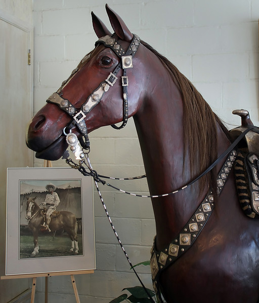 A display of a Silver trimmed saddle once belonging to Tom Mix on display at the Tom Mix Museum in Dewey Oklahoma.