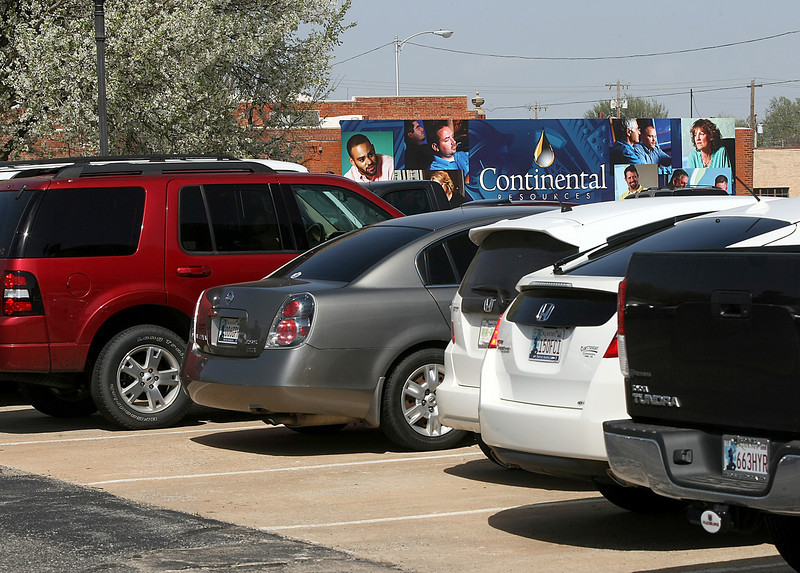 Cars still fill the parking lots at Continetal Resources. PHOTO BY MAIKE SABOLICH