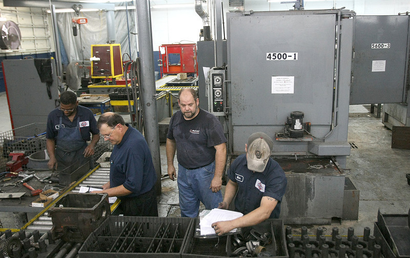 Blumenthal employees work on remodelling a transmission for Mopar Tuesday. PHOTO BY MAIKE SABOLICH