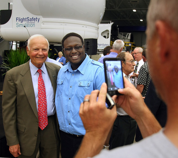Bruce Whitman, President & CEO of Flight Safety International pauses with an employee for a souvenir photo at the Grand Opening of Flight Safety's new Facility in Broken Arrow.
