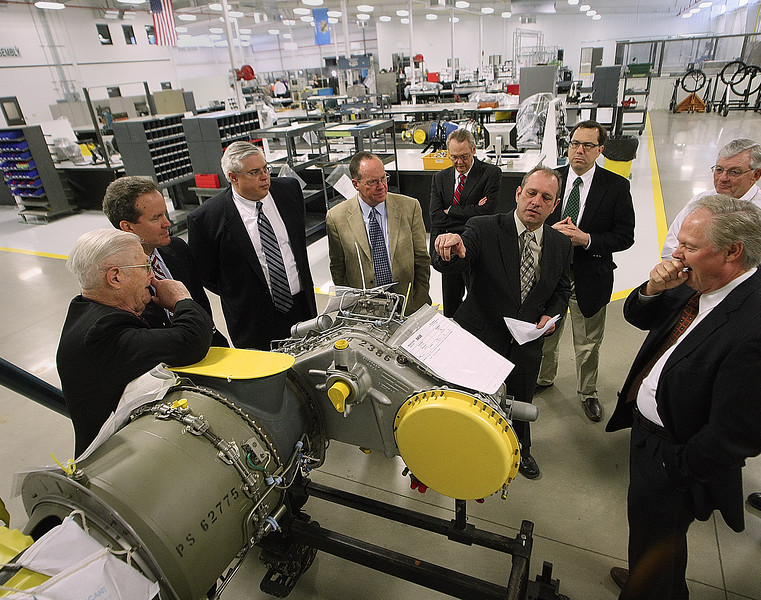 *** FILE PHOTO ***<br /> <br /> General Manager Rich Kassabula, leads the Board of Directors on a tour of Mint Turbines new 40,000 sq ft addition in Stroud.  The company repairs the turbine engines used in civilian and military helicopters.