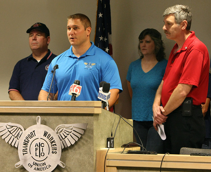 Jason Best, a Maintenance Control Technician for American Airlines, speaks at a press conference appealing to state leaders to keep 230 jobs at the Tulsa Location rather than transferring them to Dallas.
