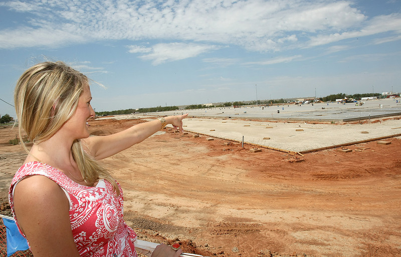 Mandi Broadfoot, Hobby Lobby spokeswoman, explains the construction of the new warehouse Tuesday.  PHOTO BY MAIKE SABOLICH