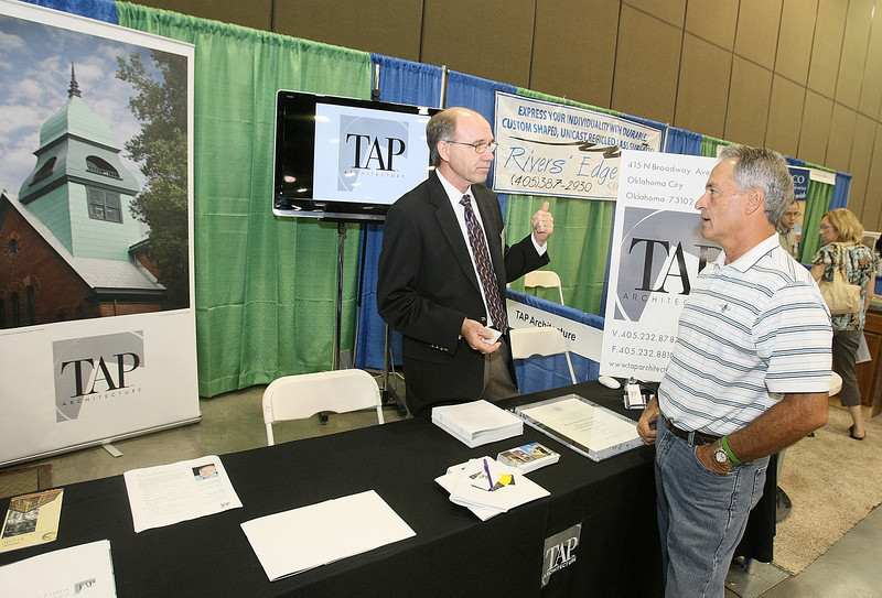 Rick Lueb with TAP and Dusty Hammack with Lumber Sales visit at the first Historic Preservation EXPO at the Cox Convention Center Friday.  PHOTO BY MAIKE SABOLICH