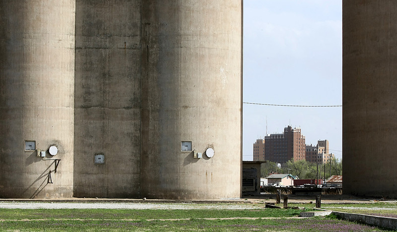 Continental Towers as seen through the Greenpasture grain elevator in Enid. PHOTO BY MAIKE SABOLICH