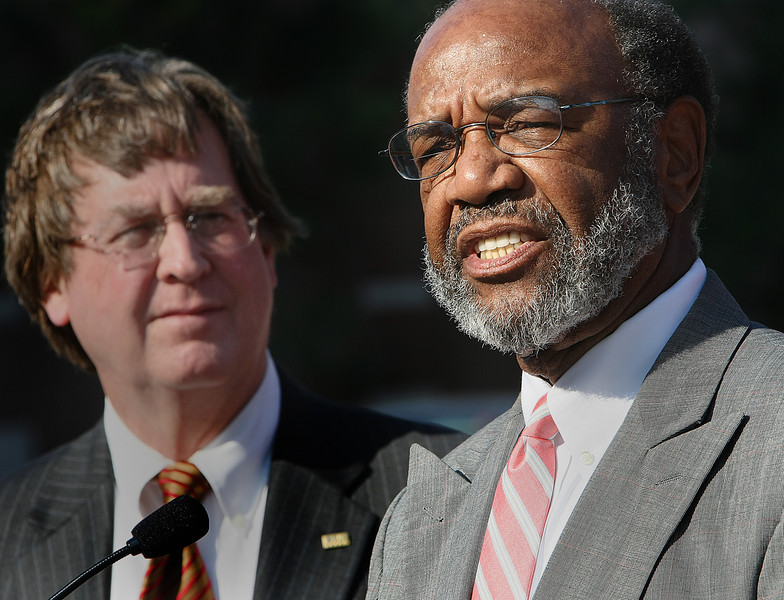 With Tulsa Mayor Dewey Bartlett looking on Julius Pegues, Chairman of the Tulsa Development Authority, announces at a press conference the availability of a few units at the Metro at Brady Arts District Apartments in Downtown Tulsa.