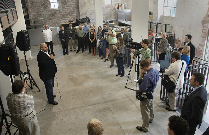 Blake Ewing, owner of Engine Room Creative, announces at a news conference that he will test a new business model with downtown Tulsa's new Brady District grocery store, the Archer Market.