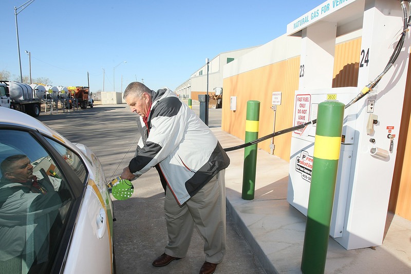 Patrick Morris with the City of Oklahoma City shows the City's new fast-fill CNG station on 1621 S. Portland Wednesday. PHOTO BY MAIKE SABOLICH