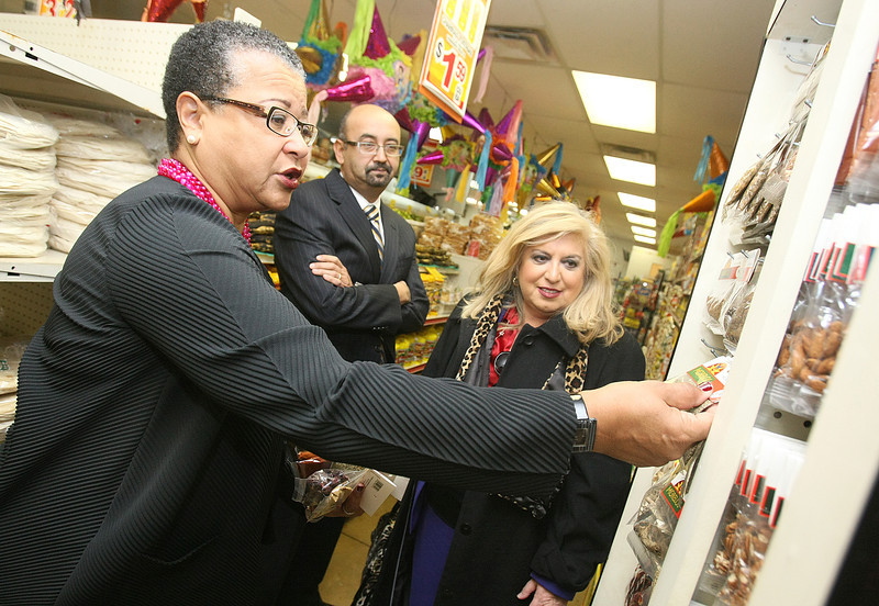 SBA Deputy Director Marie Johns checks out spices at the Hispanic grocery store Super Mercados Morelos on 23rd Street Wednesday. Behind her: Carlos Amaya and Yolanda Olivarez. PHOTO BY MAIKE SABOLICH