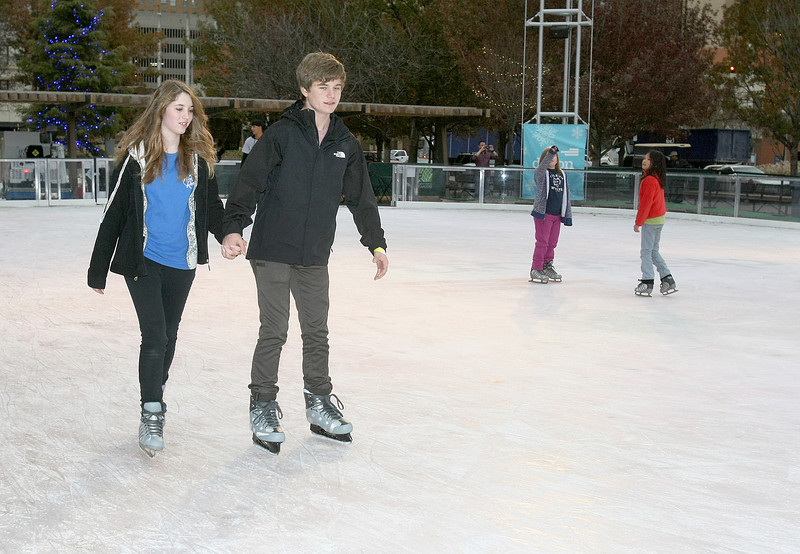 Sadie Oglesby and Alex Shaffer ice skate in the Myriad Gardens Monday. PHOTO BY MAIKE SABOLICH