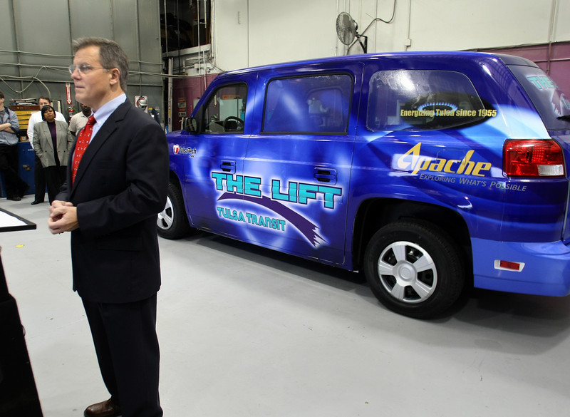 Rob Johnston, Regional VP of Apache Corporation, speaks to the crowd gathered at the Tulsa Transit Authority to receive two CNG powered vehicles the company is donating to The Lift program.