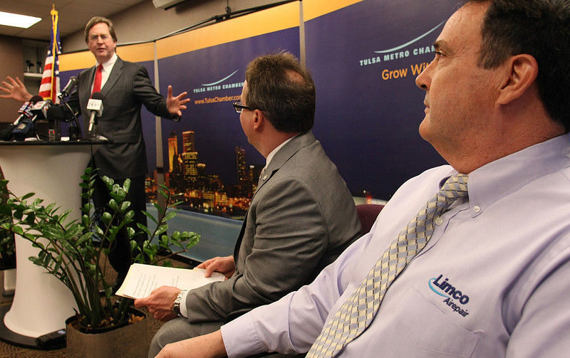 Tulsa Mayor Dewey Bartlett gestures towards Paul Hall, President of Limco Airepair, at a press conference announcing the companies plans to hire an additional 150 employees.  The company has approximately 180 employees currently.