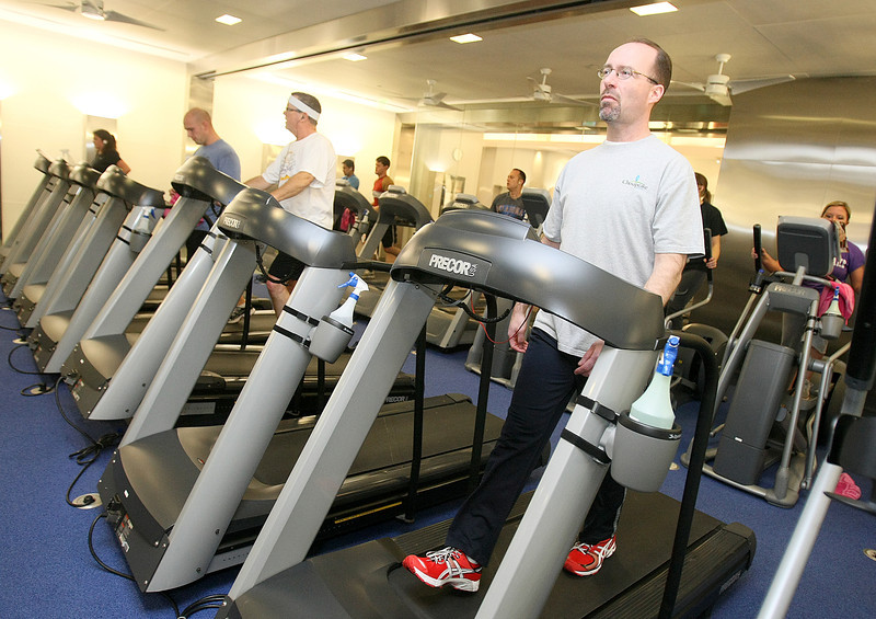 Todd George, who is enrolled in Chesapeake's Healthy Living program, works out on the treadmill at the Chesapeake gym. PHOTO BY MAIKE SABOLICH