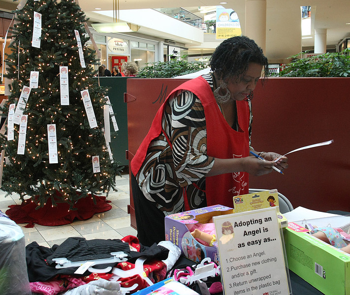 Bea Shaw, Angel Tree Coordinator for the Salvation Army of Tulsa, works to tag newly delivered presents.