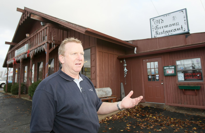 Mike Turek, owner of Old Germany in Choctaw, explains which area of the property is planned to be transformed into a sports bar. PHOTO BY MAIKE SABOLICH