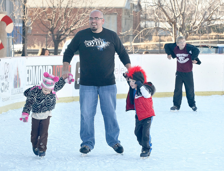 Ayla Cuthbertson, left, Terry Cuthbertson, and Blaine Unruh are skating at Edmond's ice rink Friday.  PHOTO BY MAIKE SABOLICH