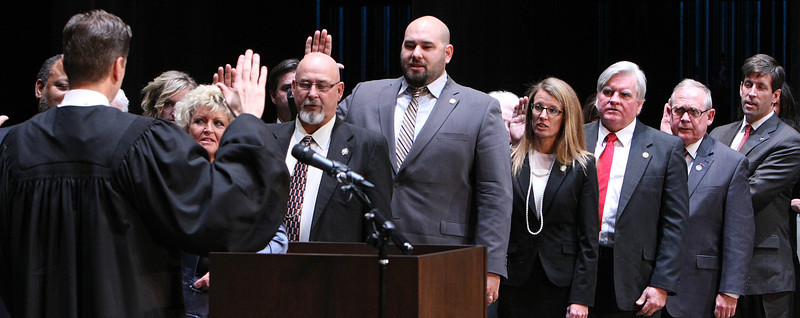 Members of the newly elected Tulsa City council are sworn into service Monday .