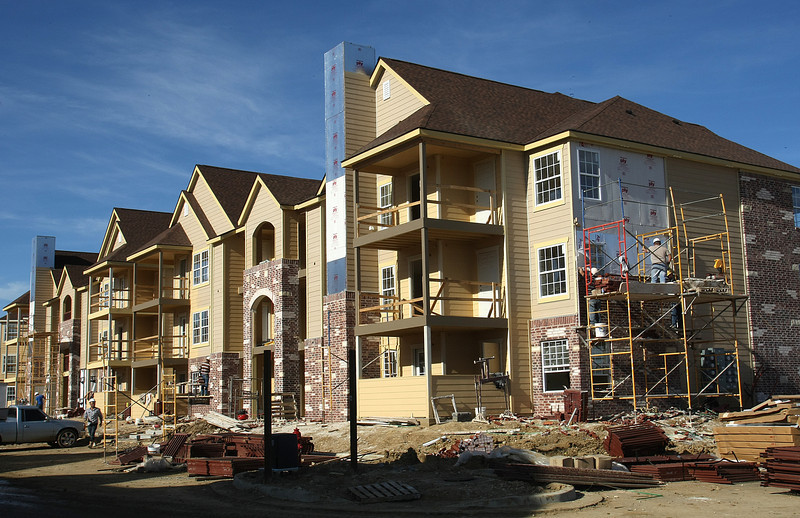 Workers brick the exterior of a phase two apartment block of the Park at Mission Hills, a 286-unit addition to a Case and Associates complex with 308 finished units in Broken Arrow.  Joan Hester, the new construction bookkeeper for Case, said projected the $21.8 million addition will not be complete until around May.