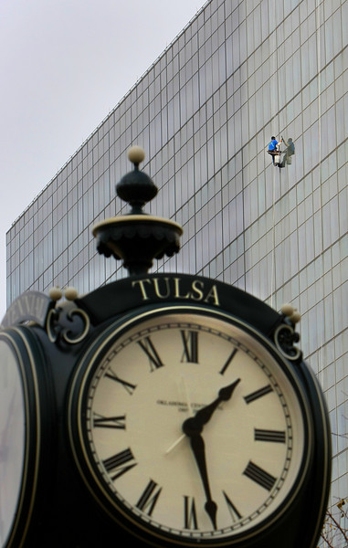 A window washer plys his trade on side of Tulsa's City Hall Thursday.
