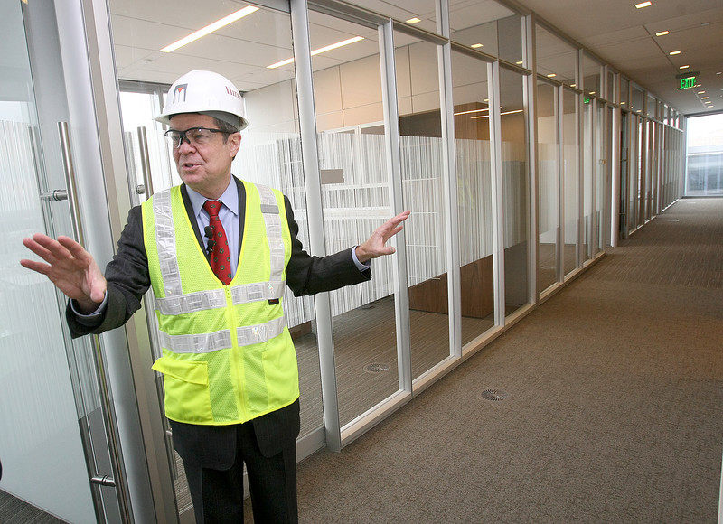Larry Nichols shows the hallways in the office areas at the Devon tower.  Each hallway ends in a window view. PHOTO BY MAIKE SABOLICH