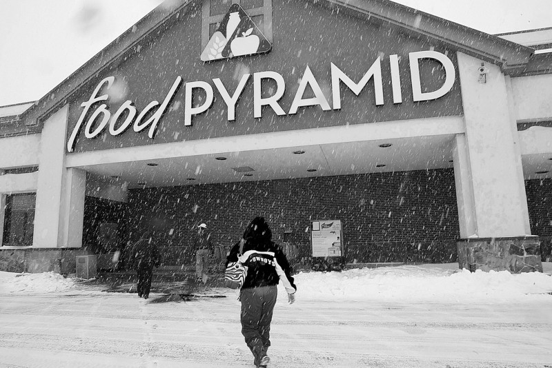 Braving the newest snow customers of a Tulsa Food Pyramid grocery store head inside to stock up on supplies for the weekend.