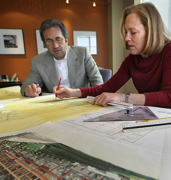 Roberto Moran and Rachel Zebrowski look over plans of a clients.