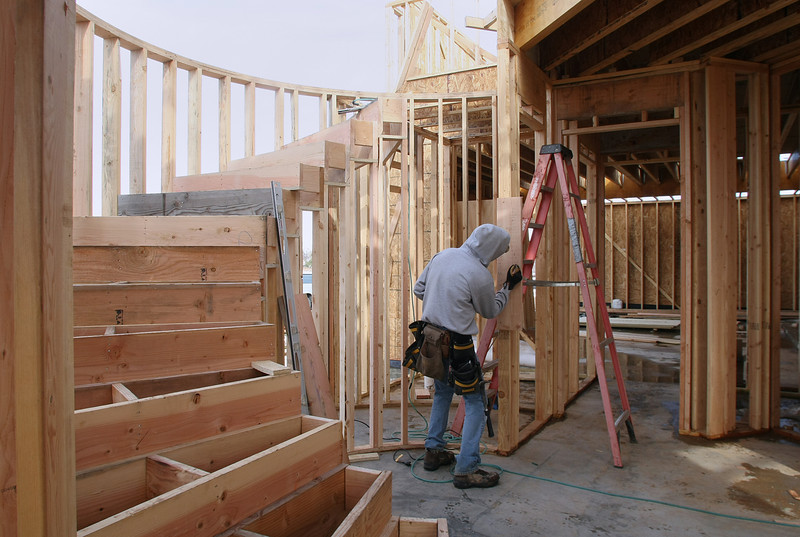 Workman frame a house in Tulsa's Berwick Fairways addition.