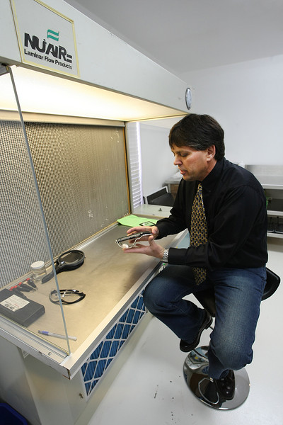 Dave Craig, co-founder of Fathom Electronics LCC, works on a prototype fish finder display his new company is developing.