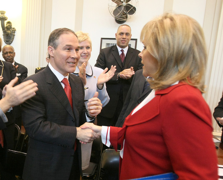 Attorney General greets Gov. Mary Fallin before the State of the State address Monday. PHOTO BY MAIKE SABOLICH