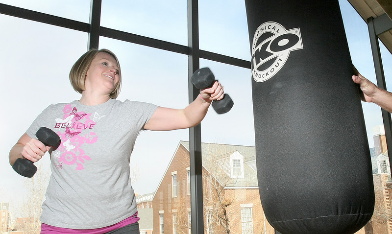 Melissa Costello works out at the Chesapeake Wellness Center. PHOTO BY MAIKE SABOLICH
