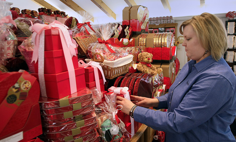 Valeri Martin , Store Manager of the Russell Stover Candy Store in Utica Square Shopping center, works stocking the stores inventory of Valentines Day candies.