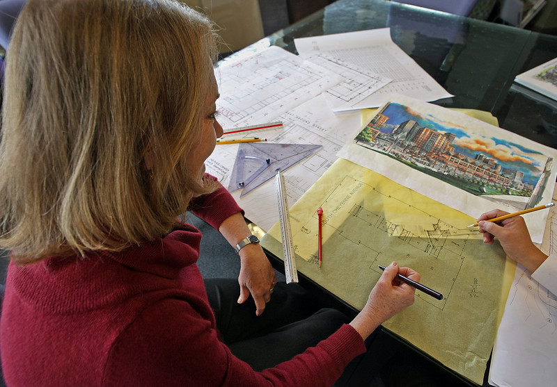 Architect Rachel Zebrowski look over plans of a clients.