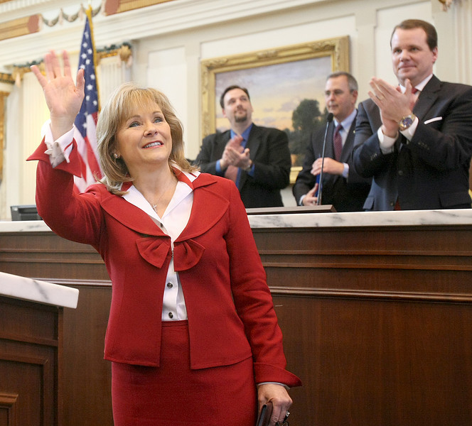 Gov. Mary Fallin waves to the crowd before her first State of the State address Monday at the House of Representatives. PHOTO BY MAIKE SABOLICH