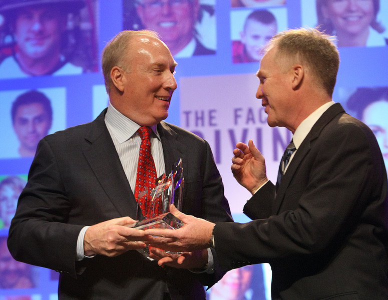 Stan Lybarger, CEO of the Bank of Oklahoma, accepts the Tulsa Area United Ways new Williams Summit Leadership Award from Alan Armstrong, Williams Companies President.