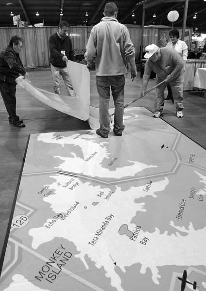 Vendors install a sticker of the Grand Lake area at the Tulsa Boat Sports & Travel Show at the QT Center in Tulsa.