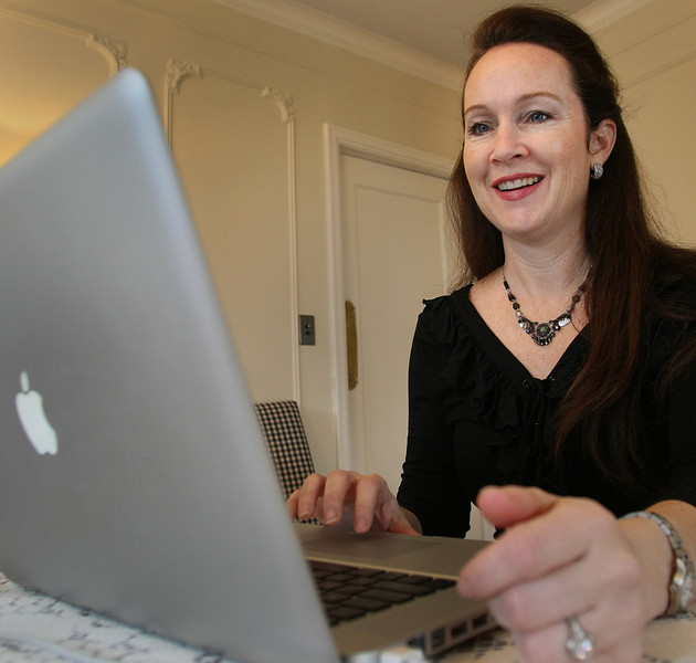Cathy Fox works from her home office to get her new business up on its feet.