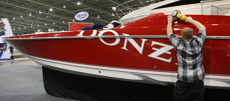 Ugly John's employee Jason Acosta polishes a boat to prepare for the Tulsa Boat Sports & Travel Show at the QT Center in Tulsa.