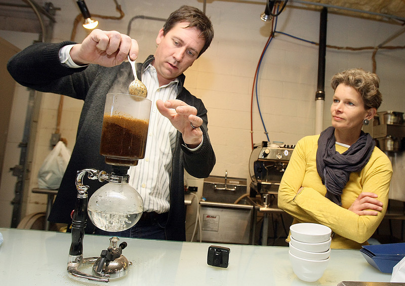 Chris Holliday and Lauren Massenat with Elemental Coffee make coffee with a vac pot Thursday. PHOTO BY MAIKE SABOLICH
