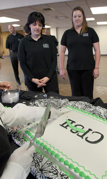 Employees of CFS II gather for a slice of cake to celebrate hiring their 100th Employee.