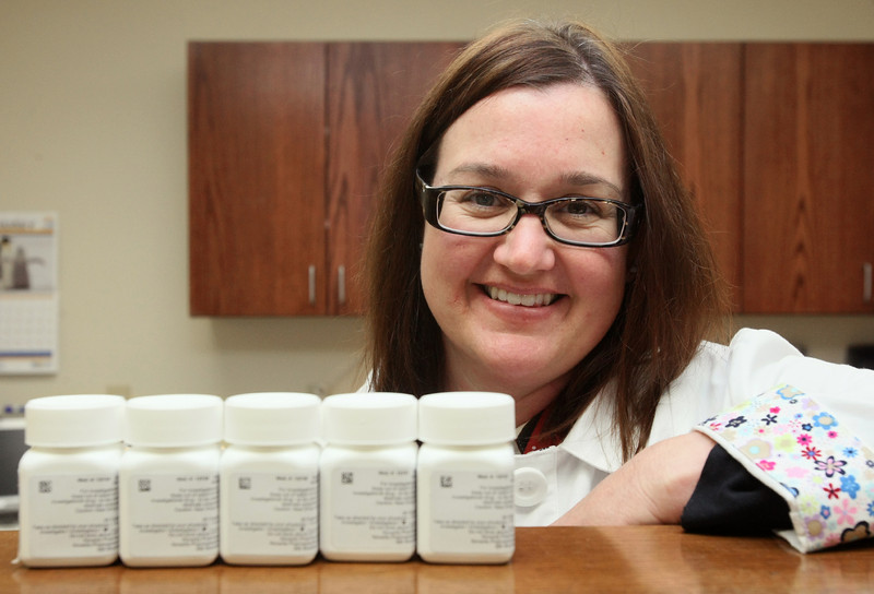 Dr. Jennifer Robert, director of research with the Lynn Institute, with FDA-approved medicine for MS. PHOTO BY MAIKE SABOLICH