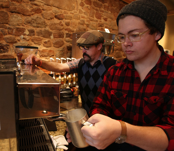 Marty Peercy and Nick Oxford work up an espresso at the Sips Downtown Kafé in Shawnee.