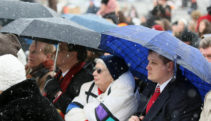 Despite cold temperatures and snow, Fran Sturgis, Guy Sheffield and others gathered at the State Capitol Monday for May Fallin's gubernatorial inaugruation Monday. PHOTO BY MAIKE SABOLICH