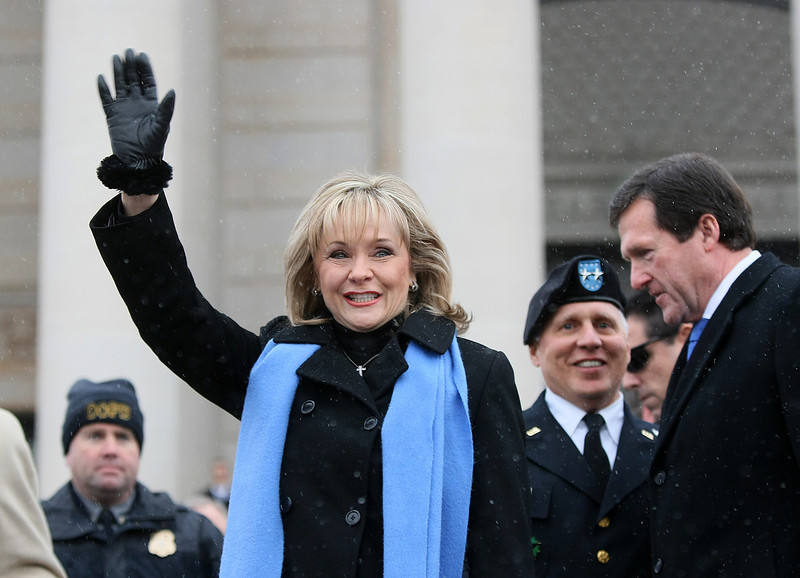 Governor Mary Fallin waves to the crowd momentys before being sworn in Monday. PHOTO BY MAIKE SABOLICH