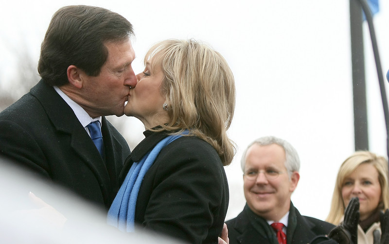 First Gentleman Wade Christensen kisses Governor Mary Fallin after she was sworn in Monday on the steps of the State Capitol. PHOTO BY MAIKE SABOLICH