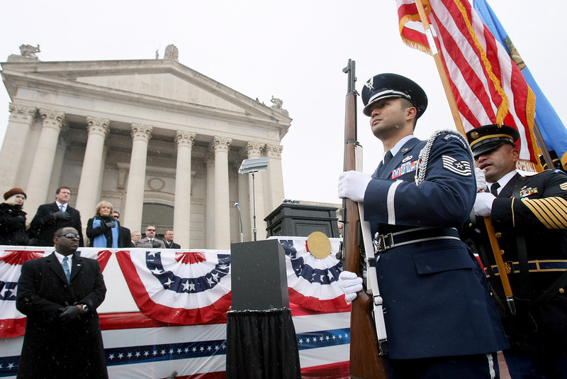 The color guard marches in front of the steps of the State Capitol during the 2011 Inaugruation of Mary Copeland Fallin Monday. PHOTO BY MAIKE SABOLICH