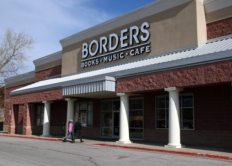 Customers head into a Borders bookstores in Tulsa.