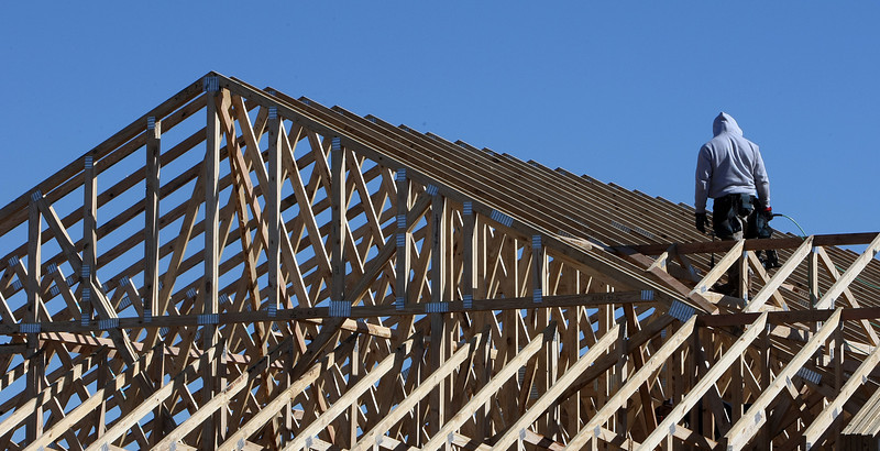 A workman assembles roofing trusses at the Alzheimer's & Memory Care facility under construction in Tulsa.